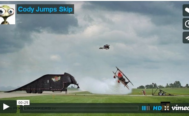 Watch a Motorcycle Jump Over a Plane